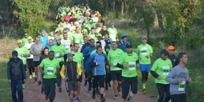 """صورة """"الخطوة الخضراء"""" تجمع هواة الجري والمشي في بوسكورة"""